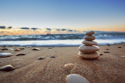 Stones balance on beach sunrise shot. Stock image